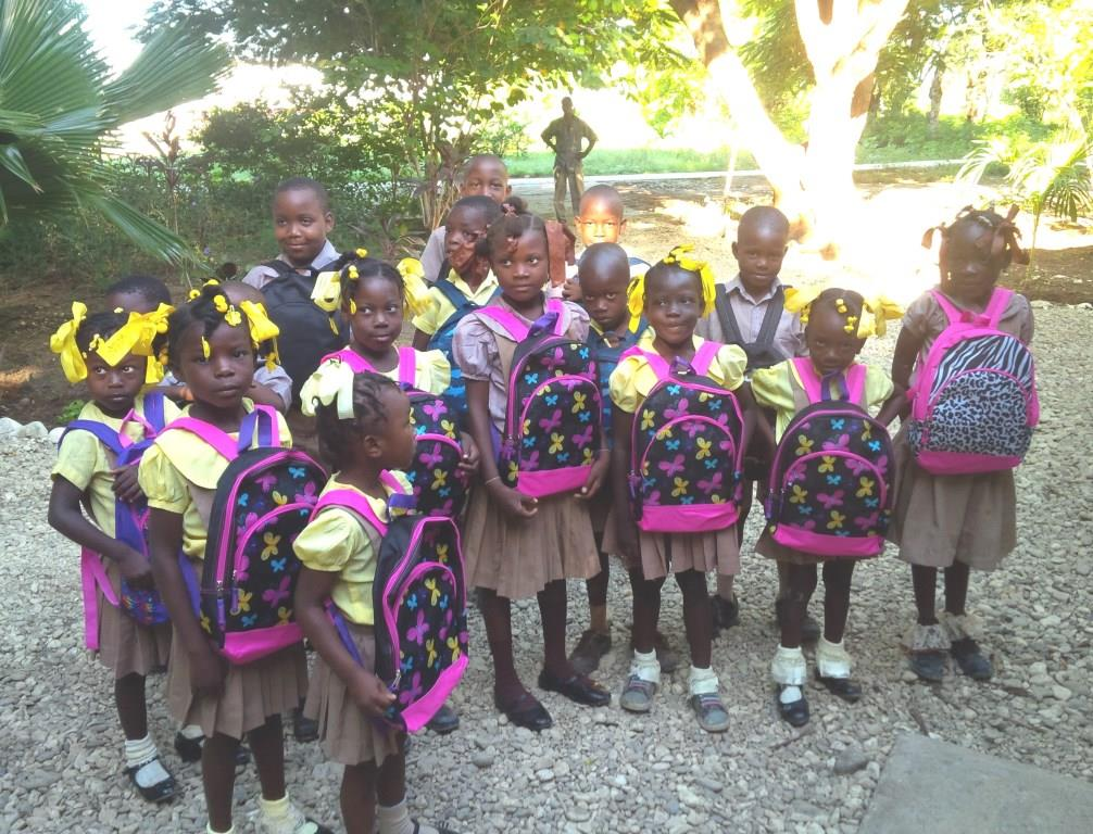 Proud Of Their New Donated Bookbags
